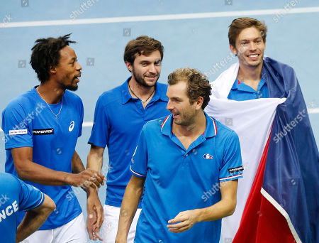 France's players Gael Monfils, Gilles Simon, Julien Benneteau and Nicolas Mahut, from left, celebrate after Mahut and Benneteau won their doubles against Germany's Benjamin Becker, and Andre Begemann during a first round tennis Davis Cup match between Germany and France in Frankfurt, Germany, . France has now an unassailable 3-0 lead and advances to the next round