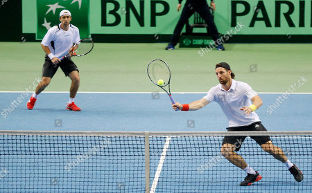 Germany's Andre Begemann, right, and Benjamin Becker play in their doubles match against France's Julien Benneteau and Nicolas Mahut during a first round tennis Davis Cup match between Germany and France in Frankfurt, Germany, . France won and has now an unassailable 3-0 lead and advances to the next round