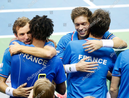 Julien Benneteau, left, and Nicolas Mahut hug their team mates after beating Germany's Benjamin Becker and Andre Begemann in the doubes during a first round tennis Davis Cup match between Germany and France in Frankfurt, Germany, . France won and has now an unassailable 3-0 lead and advances to the next round