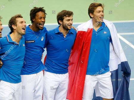 France's players Julien Benneteau, Gael Monfils, Gilles Simon and Nicolas Mahut, from left, celebrate after Mahut and Benneteau won their doubles against Germany's Benjamin Becker, and Andre Begemann during a first round tennis Davis Cup match between Germany and France in Frankfurt, Germany, . France has now an unassailable 3-0 lead and advances to the next round