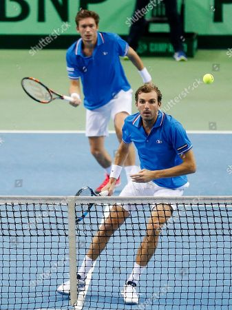 Julien Benneteau, right, and Nicolas Mahut play against Germany's Benjamin Becker and Andre Begemann in the doubles match during a first round tennis Davis Cup match between Germany and France in Frankfurt, Germany, . France won and has now an unassailable 3-0 lead and advances to the next round