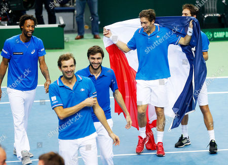 France's players Gael Monfils, Julien Benneteau, Gilles Simon and Nicolas Mahut, from left, celebrate after Mahut and Benneteau won their doubles against Germany's Benjamin Becker, and Andre Begemann during a first round tennis Davis Cup match between Germany and France in Frankfurt, Germany, . France has now an unassailable 3-0 lead and advances to the next round