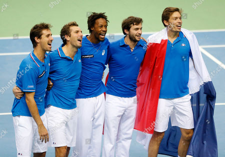France's players Edouard Roger-Vasselin, Julien Benneteau, Gael Monfils, Gilles Simon and Nicolas Mahut, from left, celebrate after Mahut and Benneteau won their doubles against Germany's Benjamin Becker, and Andre Begemann during a first round tennis Davis Cup match between Germany and France in Frankfurt, Germany, . France has now an unassailable 3-0 lead and advances to the next round