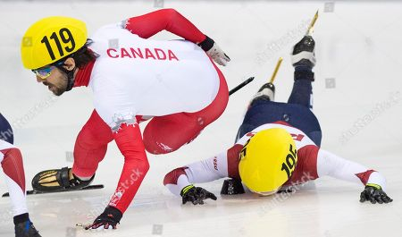 Olympic champion Victor An of Russia, right, crashes besides Olympic champion Charles Hamelin of Canada, left, during the men's 1,000 meters semi final race at the World Cup short track speed skating championship in Dresden, Germany