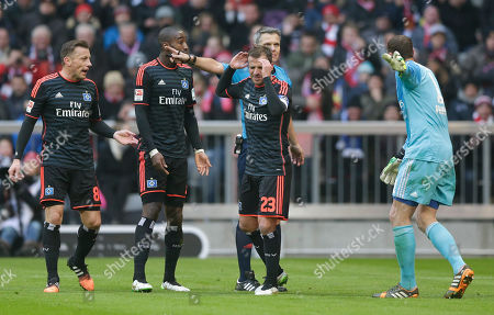 Stock Picture of Hamburg's players argue to referee Michael Weiner during the German first division Bundesliga soccer match between FC Bayern Munich and Hamburger SV in the Allianz Arena in Munich, Germany