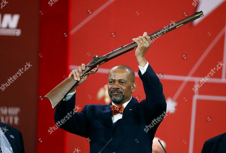 Stock Photo of David Clarke Milwaukee County Sheriff David Clarke holds up a rifle that was presented to him as part of his Charlton Heston Courage Under Fire Award at the Conservative Political Action Conference (CPAC) in National Harbor, Md