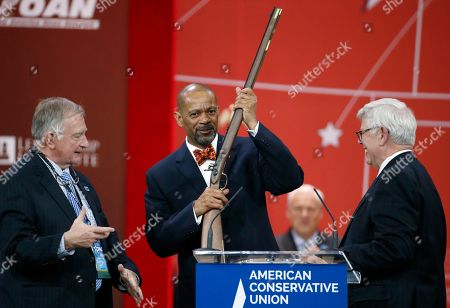 Stock Picture of David Clarke Milwaukee County Sheriff David Clarke, center, holds up a rifle that was presented to him as part of his Charlton Heston Courage Under Fire Award at the Conservative Political Action Conference (CPAC) in National Harbor, Md
