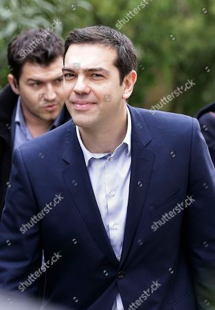Alexis Tsipras Greece's Prime Minister Alexis Tsipras arrives for a meeting with Greek composer Mikis Theodorakis in Athens, . Caught between its own defiant campaign pledges and pressure from creditors, Greece's left-wing government will deliver a list of reforms Tuesday to debt inspectors for final approval of extended rescue loans, officials said