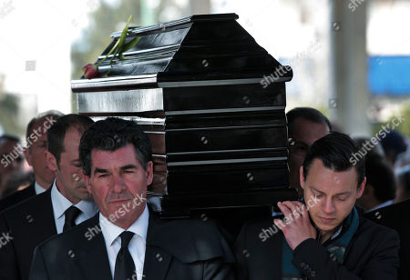 Pallbearers carry the coffin of singer Demis Roussos during his funeral procession in Athens, . Several hundred mourners gathered to bid a final farewell to the renowned singer. Roussos, whose often high-pitched pop serenades won him household recognition in the 1970s and 1980s across Europe and beyond and who sold more than 60 million records, died earlier this week at the age of 68
