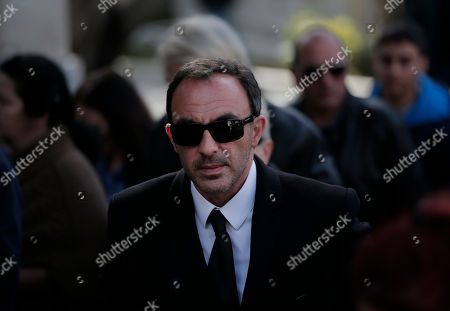 Nikos Aliagas TV host and journalist Nikos Aliagas walks in the funeral procession for singer Demis Roussos, in Athens, . Several hundred mourners gathered to bid a final farewell to the renowned singer. Roussos, whose often high-pitched pop serenades won him household recognition in the 1970s and 1980s across Europe and beyond and who sold more than 60 million records, died earlier this week at the age of 68