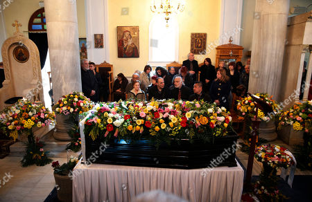 Stock Image of Mourners gather around the coffin of singer Demis Roussos in a church during his funeral procession in Athens, . Several hundred mourners gathered to bid a final farewell to the renowned singer. Roussos, whose often high-pitched pop serenades won him household recognition in the 1970s and 1980s across Europe and beyond and who sold more than 60 million records, died earlier this week at the age of 68