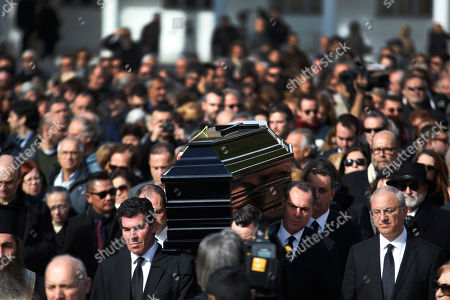 Followed by mourners, pallbearers carry the coffin of singer Demis Roussos during his funeral procession in Athens, . Several hundred mourners gathered to bid a final farewell to the renowned singer. Roussos, whose often high-pitched pop serenades won him household recognition in the 1970s and 1980s across Europe and beyond and who sold more than 60 million records, died earlier this week at the age of 68
