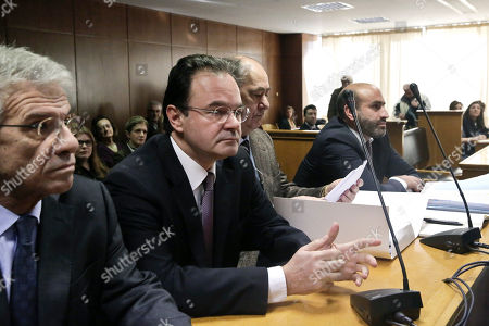 Stock Photo of George Papaconstantinou Former Greek finance minister George Papaconstantinou, second left, sits in court next to his lawyers, on at the start of a criminal trial against him on allegations he removed relatives' names from a list of Greeks holding Swiss bank accounts in HSBC.Papaconstantinou, 53, denies charges that he doctored the document, known in Greece as the Lagarde List, to remove three of his relatives. he was finance minister from late 2009 to mid 2011 and It was under him that Greece signed its first international bailout in May 2010