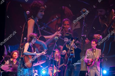 Oscar Isaac, Gaby Moreno Actor Oscar Isaac, front right, performs with Guatemala's singer Gaby Moreno during a concert in Guatemala City, late