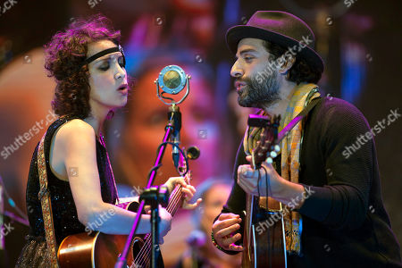 Oscar Isaac, Gaby Moreno Actor Oscar Isaac, right, performs with Guatemala's singer Gaby Moreno during a concert in Guatemala City, late