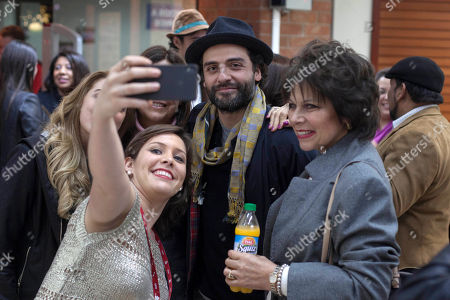 Oscar Isaac, Gaby Moreno Fans takes backstage pictures with actor Oscar Isaac after a concert with Guatemalan singer Gaby Moreno in Guatemala City, late