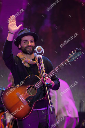 Oscar Isaac, Gaby Moreno Actor Oscar Isaac waves as he performs in concert with Guatemala's singer Gaby Moreno in Guatemala City, late