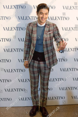 Choi Siwon Choi Siwon, center, a member of South Korean pop group Super Junior, poses during a promotional event for the opening of a new store for the fashion brand Valentino in Hong Kong