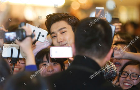 Choi Siwon Choi Siwon, center, a member of South Korean pop group Super Junior, takes a selfie with his fans during a promotional event for the opening of a new store for the fashion brand Valentino in Hong Kong