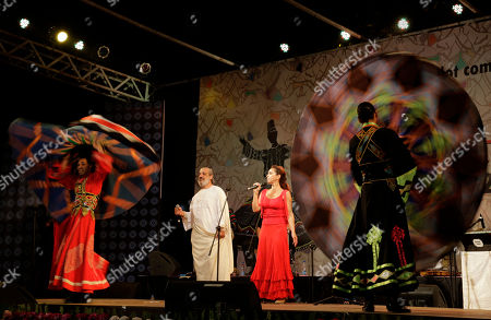 Egyptian singer Amer Eltony, in white robe, Moroccan singer Karen Ruimy and artists of Egyptian Mawlawiyahh group perform during Sufi Sutra, an international festival of Sufi and traditional music, in Kolkata, India. Besides Indian states of Rajasthan, Gujarat and West Bengal, international participants from Brazil, Denmark, Egypt, Morocco, Tunisia and Spain are also present in this three-day event
