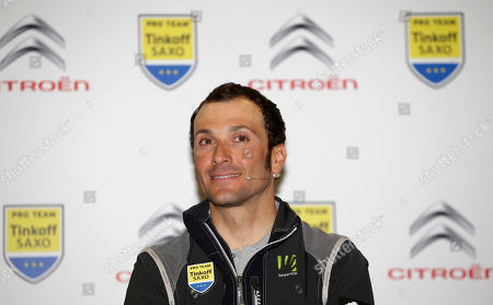 Ivan Basso Ivan Basso, of Italy, smiles during a presentation of Tinkoff-Saxo cycling team in Milan, Italy