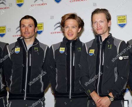Christopher Juul-Jensen, Matti Breschel, Ivan Basso Christopher Juul-Jensen, of Denmark, center, poses for photographers with his countryman Matti Breschel, right, and Ivan Basso, of Italy, during a presentation of Tinkoff-Saxo cycling team in Milan, Italy