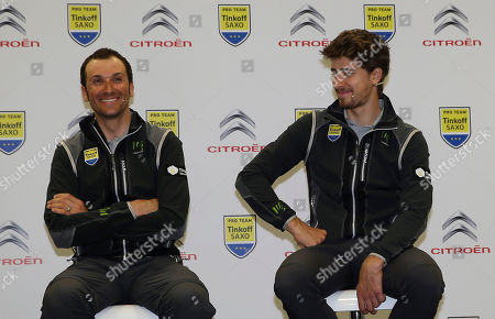 Ivan Basso, Peter Sagan Ivan Basso, of Italy, and Peter Sagan, of Slovakia, smile during a presentation of Tinkoff-Saxo cycling team in Milan, Italy
