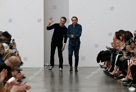 Tommaso Aquilano, right, and Roberto Rimondi acknowledge the applause at the end of the presentation of the Aquilano.Rimondi women's Fall-Winter 2015-2016 collection, part of the Milan Fashion Week, unveiled in Milan, Italy