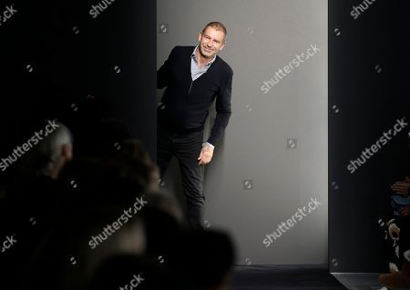 German designer Tomas Maier acknowledges the applause at the end of the presentation of the Bottega Veneta women's Fall-Winter 2015-2016 collection, part of the Milan Fashion Week, unveiled in Milan, Italy