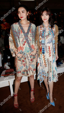 Stock Image of Chinese actress Song Jia, left, is flanked by Chinese actress Wang Likun attend the Etro women's Fall-Winter 2015-16 show, part of the Milan Fashion Week, unveiled in Milan, Italy