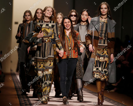 Veronica Etro Italian fashion designer Veronica Etro, center, acknowledges the applause at the end of her Etro women's Fall-Winter 2015-16 show, part of Milan Fashion Week, unveiled in Milan, Italy