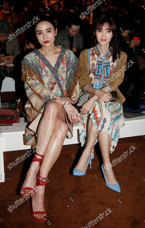 Stock Picture of Chinese actress Song Jia, left, is flanked by Chinese actress Wang Likun attend the Etro women's Fall-Winter 2015-16 show, part of the Milan Fashion Week, unveiled in Milan, Italy