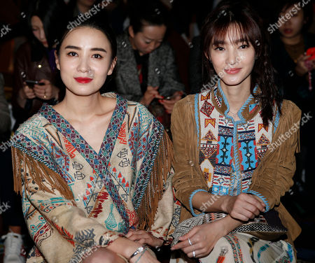 Stock Photo of Chinese actress Song Jia, left, is flanked by Chinese actress Wang Likun attend the Etro women's Fall-Winter 2015-16 show, part of the Milan Fashion Week, unveiled in Milan, Italy