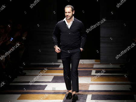 Italian Fashion designer Massimiliano Giornetti acknowledges the applause of the audience after presenting the Salvatore Ferragamo women's Fall-Winter 2015-2016 collection, part of the Milan Fashion Week, unveiled in Milan, Italy