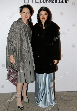 """Luisa Beccaria, left, and Lucilla Bonaccorsi arrive for the """"Vogue Talents Corner.com """"party during the Milan Fashion Week, unveiled in Milan, Italy"""
