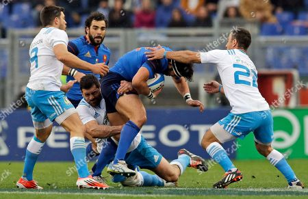 Maxime Mermoz, Luciano Orquera, Edoardo Gori, Andrea Masi France's Maxime Mermoz, second from right, is tackled by Italy's Edoardo Gori, left, Andrea Masi, center, and Luciano Orquera, right, during a Six Nations rugby union match between Italy and France, at Rome's Olympic Stadium