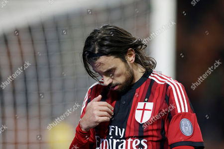 AC Milan's Cristian Zaccardo makes the sign of the cross as he celebrates after scoring during a Serie A soccer match between AC Milan and Parma, at the San Siro stadium in Milan, Italy, Sunday, Feb.1, 2015