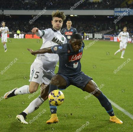 Napoli's Duvan Zapata, right, and Sassuolo's Luca Antei vie for the ball during a Serie A soccer match between Napoli and Sassuolo, at the San Paolo stadium in Naples, Italy