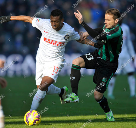 Matteo Brighi, Fredy Guarin Sassuolo's Matteo Brighi, right, vies for the ball with Inter Milan's Fredy Guarin, during their Serie A soccer match at Reggio Emilia's Mapei stadium, Italy
