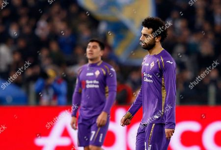 David Pizarro Mohamed Salah Fiorentina's David Pizarro, left, and Mohamed Salah leave the pitch at the end of a Serie A soccer match between Lazio and Fiorentina, at Rome's Olympic stadium, . Miroslav Klose scored twice and Lazio made a big statement in the battle for Serie A's final Champions League spot with a 4-0 win over Fiorentina on Monday