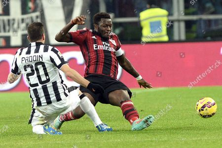 AC Milan' Sulley Muntari, right, is challenged by Juventus' Simone Padoin during a Serie A soccer match at the Juventus stadium, in Turin, Italy