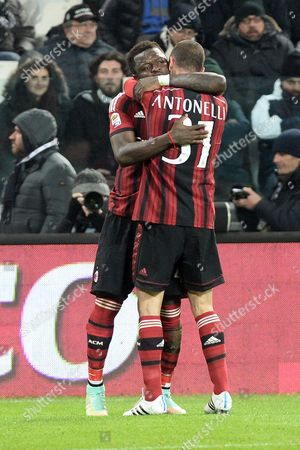AC Milan's Luca Antonelli, right, celebrates with his teammates Sulley Muntari, after scoring during a Serie A soccer match between Juventus and AC Milan at the Juventus stadium, in Turin, Italy