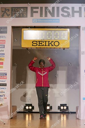 Stock Photo of Tiki Gelana Tiki Gelana, Ethiopian distance runner and 2012 London Olympic gold medalist, walks in the venue of a press conference of Tokyo Marathon 2015 in Tokyo . The Tokyo race is one the World Marathon Majors along with Boston, Chicago, London, Berlin and New York