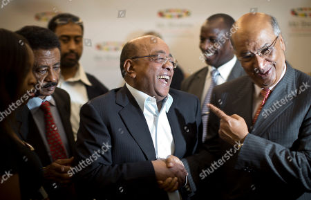 Mo Ibrahim, Naushad Merali, Beyene Russom Mo Ibrahim, Chairman and Founder of the Mo Ibrahim Foundation, center, shares a joke with Kenyan businessman Naushad Merali, right, as Eritrea's ambassador to Kenya Beyene Russom, left, looks, after a press conference where the winner of the 2014 Ibrahim Prize for Achievement in African Leadership was announced, in Nairobi, Kenya . Namibian President Hifikepunye Pohamba has won the 2014 Ibrahim Prize for African leadership, the first African leader deemed worthy of the honor since 2011