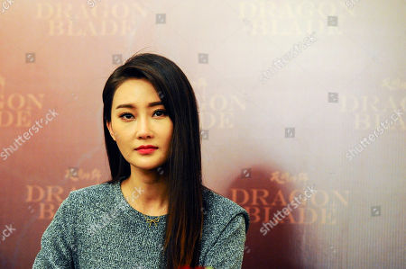 """Lin Peng Chinese actress Lin Peng looks on during a press conference to promote her new movie """" Dragon Blade"""" in a hotel in Kuala Lumpur, Malaysia, on"""