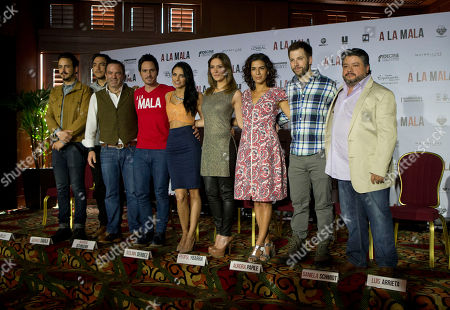 "Stock Picture of Billy Mendez, Rodrigo Davila, Pitipol Ybarra, Mauricio Ochmann, Aislinn Derbez, Aurora Papile, Daniela Schmidt, Luis Arrieta, Jorge Aragon Cast and crew of the film ""A La Mala,"" pose for a group photo during a press conference to promote the film, in Mexico City. From left, are, composers Billy Mendez and Rodrigo Davila, of the band Motel; director Pitipol Ybarra; lead actors Mauricio Ochmann and Aislinn Derbez; supporting actors Aurora Papile, Daniela Schmidt, and Luis Arrieta; and producer Jorge Aragon"