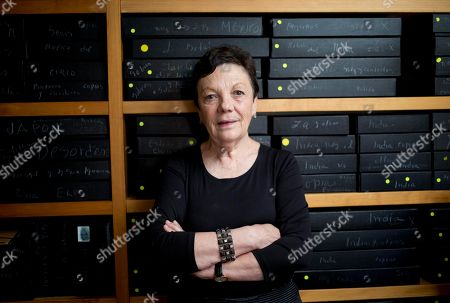 Graciela Iturbide Mexican photographer Graciela Iturbide poses for a picture in front of her archived negatives during an interview with the Associated Press at her home in Mexico City, . Iturbide who is known for black-and-white photos of Mexican people and landscapes has been given the Cornell Capa Lifetime Achievement Award