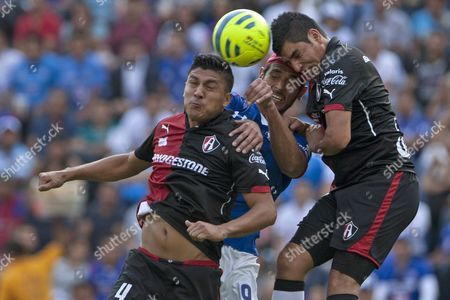 Roque Santa Cruz, Luis Venegas, Enrique Perez Atlas' Enrique Perez, left, and teammate Luis Venegas compete with Cruz Azul's Roque Santa Cruz, to head a ball during a Mexican soccer league match in Mexico City
