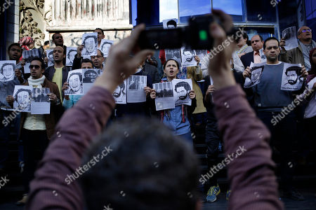 "Journalists hold placards of photojournalists Mahmoud Abu Zied, known as ""Shawkan,"" and Ahmad Jamal Ziyadah to protest against their detention during a rally in front of the Syndicate of Journalists building in Cairo, Egypt, . Shawkan, an Egyptian freelance photographer, was arrested on Aug. 14, 2013, while covering the government forces' deadly dispersal of sit-in supporters of the ousted President Mohammed Morsi at the Rabaah al-Adawiya mosque"