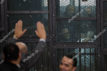 Mohammed Badie An Egyptian lawyer greets Muslim Brotherhood Supreme Guide Mohammed Badie, center, as he appears in a courtroom cage in Cairo, Egypt, . The Egyptian court sentenced four members of the banned Muslim Brotherhood organization to death and 14 to life in prison on Saturday. Badie and his deputy Khairat al-Shater were among those sentenced to life, along with former lawmaker Mohammed el-Beltagy and party head Saad el-Katatni and his deputy, Essam el-Erian. The men were accused of murder and possession of firearms, among other charges. The verdicts can be appealed